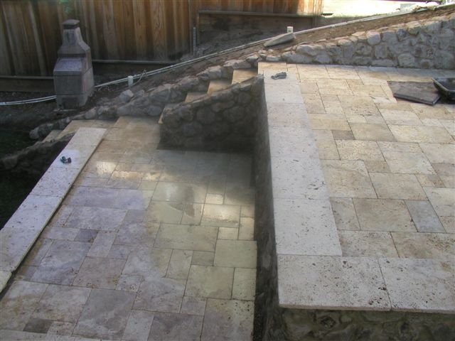 San Ramon: Travertine Patio, Extended Bull Nosed Stone Seating Wall, Raised  Stone Boarder Beds And Contained Black Bamboo With Redwood Arbor.